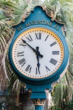 augustine: A pedestal street clock in historic St. Augustine, Florida, USA Stock Photo