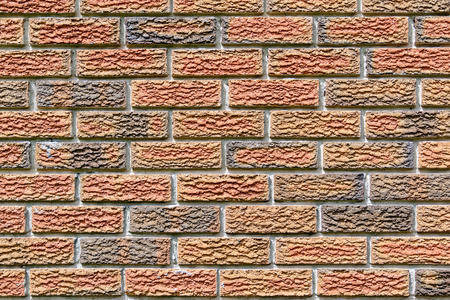 dominant color: Details of a red brick wall Stock Photo