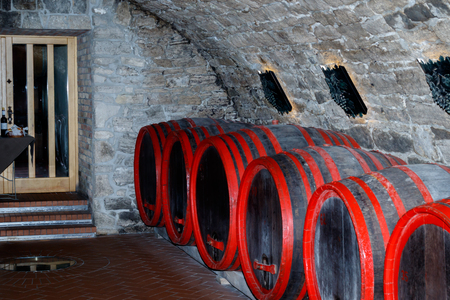 wood staves: A row of wooden barrels in a wine cellar