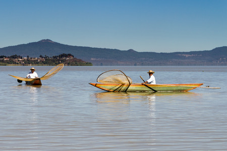 Fishermen with their traditional butterfly shaped nets and wooden boats on Lake Patzcuaro, Michoacan, Mexico