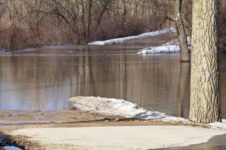 Road through the park in closed due to flooding in Mankato, Mn. Imagens - 128193901
