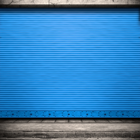 Painted corrugated metal door with conrete wall and ground.  Stock Photo - 16807041