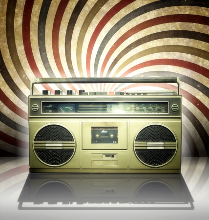 Vintage stereo player in spiral background