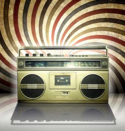 blaster: Vintage stereo player in spiral background