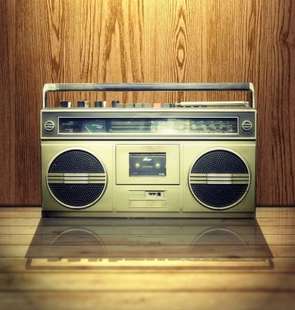 Vintage stereo player in wooden background