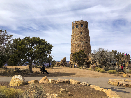 Arizona, America, 9th, March, 2018: Desert View Watchtower at daytime, is a 70-foot (21m)-high stone building located on the South Rim of the Grand Canyon within Grand Canyon National Park in Arizona. 版權商用圖片 - 124496756