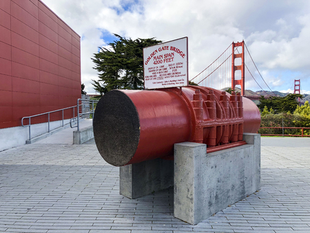 San Francisco, America, 14th, March, 2018: A 36.5-inch-wide (93 cm) cross-section of the cable, containing 27,572 wires, is on display. With Goden Gate Bridge in the background.