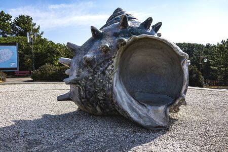 Huge conch on the sand road in the park at Jeju Korea.