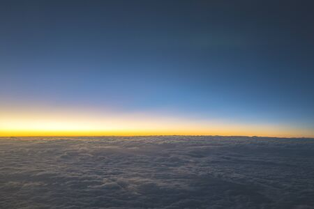 Nature landscape blue skyline and cloudscape in the twilight. Seen from the airplane. 版權商用圖片