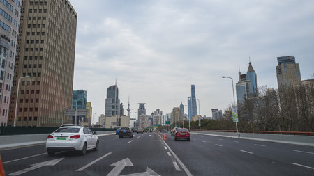 Shanghai, China, March, 2019. Street view seen from car of Shanghai, the largest city in China by population.