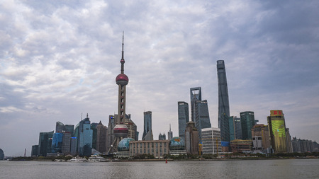 Shanghai, China, March, 2019. Lujiazui skyline, as seen from the Bund, across the Huangpu River, the tallest building being Shanghai Tower. Lujiazui is a national-level development zone designated by the government