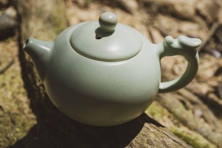 Tea culture, outdoor close up shot of the tea pot.