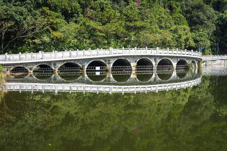Shenzhen, China. Oct, 2019. The Eleven-Arch Bridge at Fairylake Botanical Garden, or Xianhu Botanical Garden  located at Luohu District, Shenzhen, Guangdong, China. 版權商用圖片