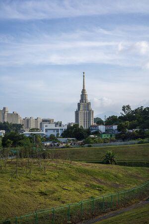 View of Dayun Nature Park in the daytime. Shenzhen MSU-BIT University in the background.