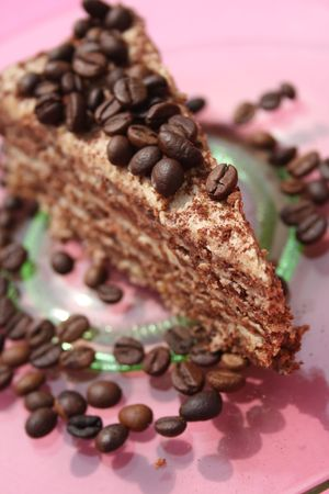 Piece of coffee cream cake on a plate. Stock Photo