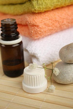 Aromatherapy oil, stones and towels. Stock Photo - 4544075