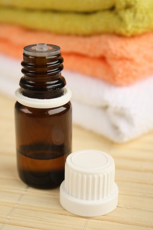 Tea tree oil and towels. Stock Photo - 4544071