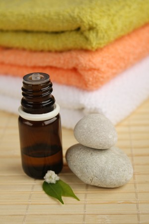 Aromatherapy oil, stones and towels.