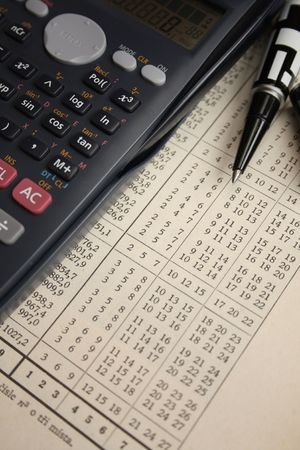 Finance instruments: pen, calculator and newspaper. Stock Photo