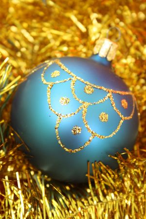 Christmas bauble on a gold decoration.