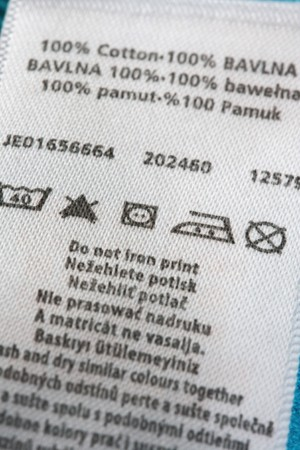 Clothing label with information note.