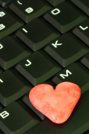 Red heart on the computer keyboard. Stock Photo - 7586979