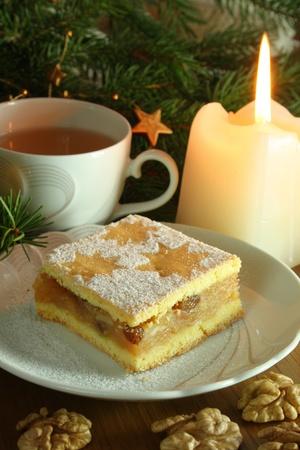 tea candles: Wristmas cake wiht cup of tea. Stock Photo