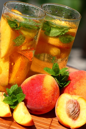 Glass of fruity ice tea perfect for hot summer