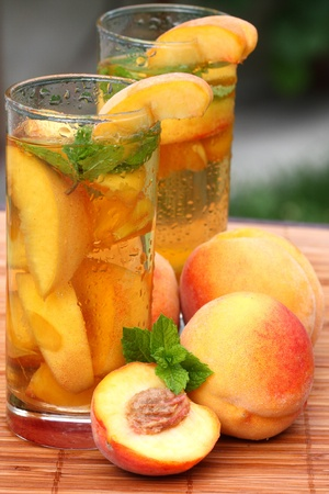 Glass of fruity ice tea perfect for hot summer photo