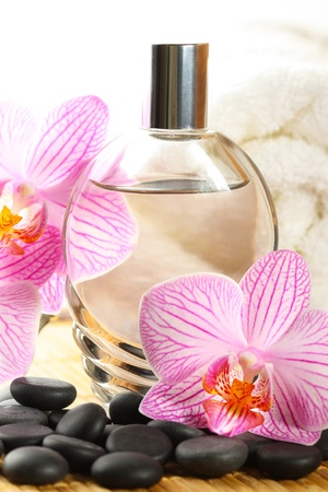 perfume oil: Perfume bottle, orchid flower and white towel