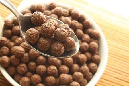 Spoon and bowl with chocolate balls  Stock Photo