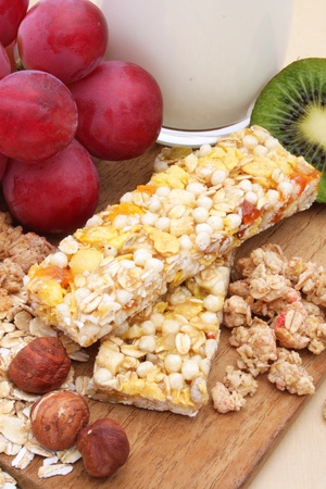 Cereal bar with grapes, kiwi and milk  photo