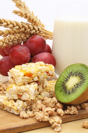 Cereal bar with grapes, kiwi and milk  Stock Photo
