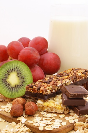 Chocolate cereal bar with grapes, kiwi and nuts
