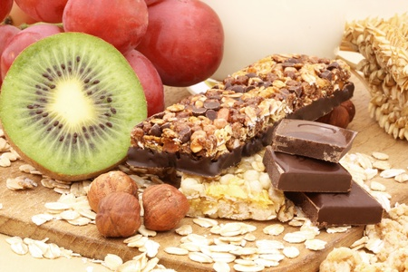 Chocolate cereal bar with grapes, kiwi and nuts  photo