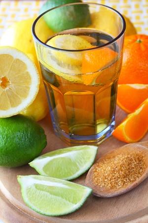 Ice tea - drink with lemon, lime and orange  photo