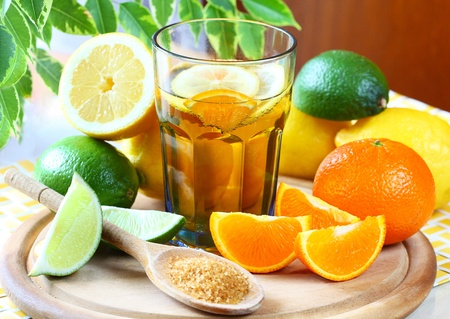 Alcohol drink with lemon, lime and orange