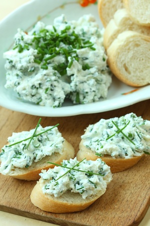 Baguette slices with spread from chives on cutting board Stock Photo - 13457374