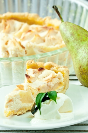 Piece of cottage cheese cake with pear and vanilla ice cream  Stock Photo