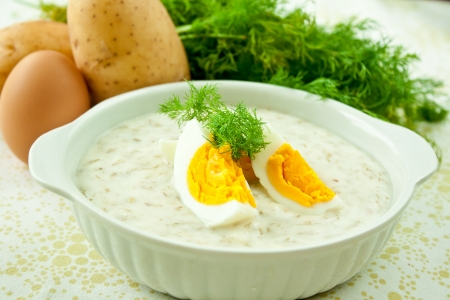 Dill soup with egg and potatoes in a white bowl  photo