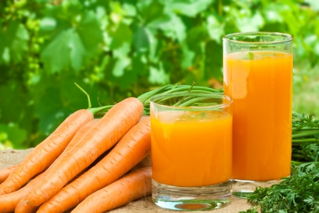 Glass of fresh carrot juice – healthy drink  Stock Photo