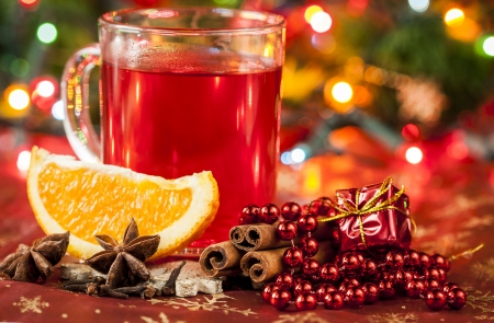 Hot winter drink with spices and orange