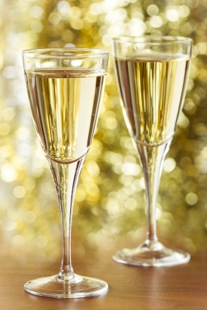 stemware: Two glasses of champagne and gold background Stock Photo