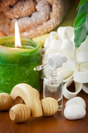 Bottle of aromatherapy oil and candle  Stock Photo - 17781043