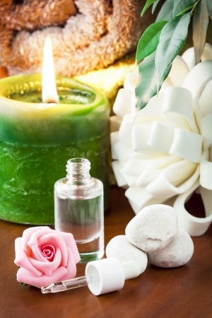 Bottle of aromatherapy oil and candle  Stock Photo