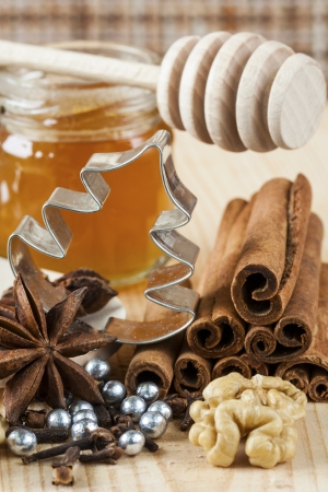 Baking ingredients such as star anise, clove, cinnamon, and honey  for christmas baking  Stock Photo