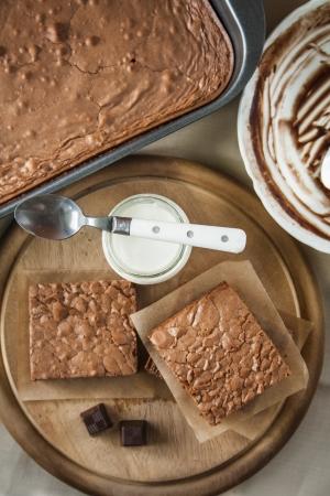 Fresh baked chocolate brownie with yogurt  Stock Photo - 18155414