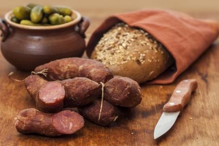 Sliced pork sausage on wooden table
