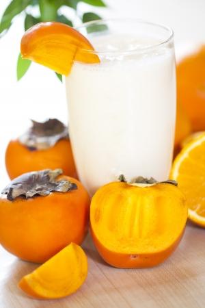 Milk shake with fruit -  kaki  Stock Photo