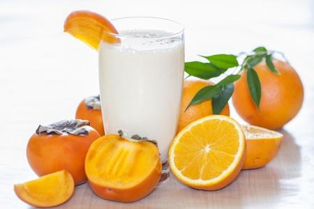 Milk shake with fruit -  orange and kaki  Stock Photo
